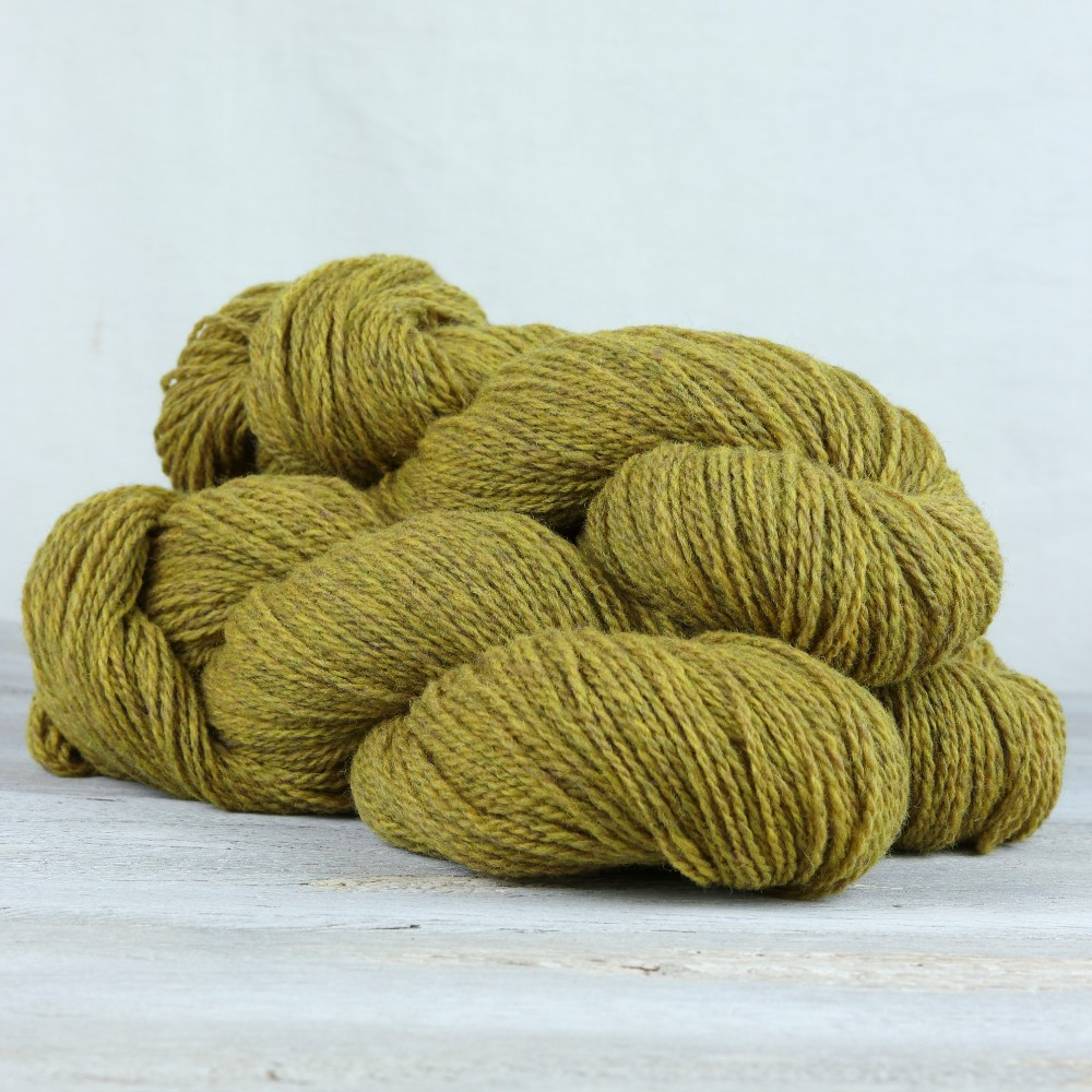 Pile of yellow heathered lambswool yarn