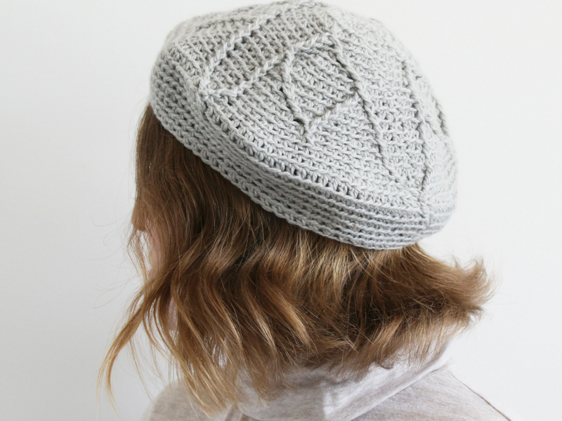 Grey crochet beret with floral design at the crown