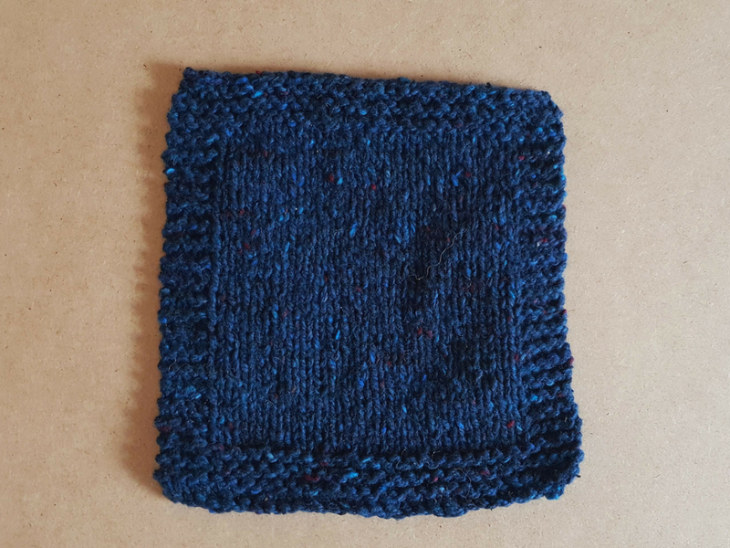 Blue stockinette gauge swatch knitted in The Fibre Co Arranmore in Meara