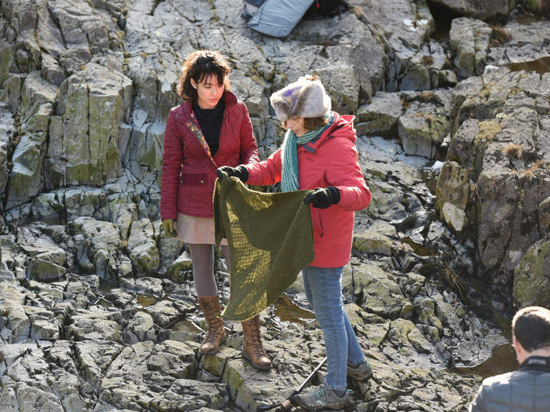 Daphne styling our model in a green textured triangle shawl