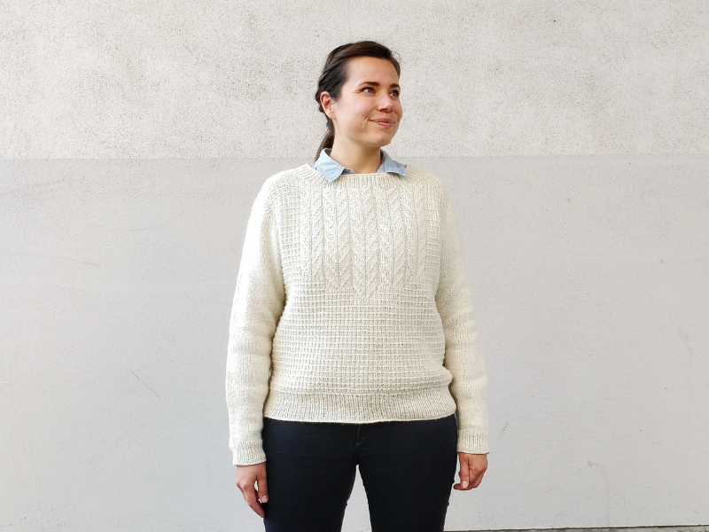 Sari Nordlund wearing cream Brandelhow sweater smiling