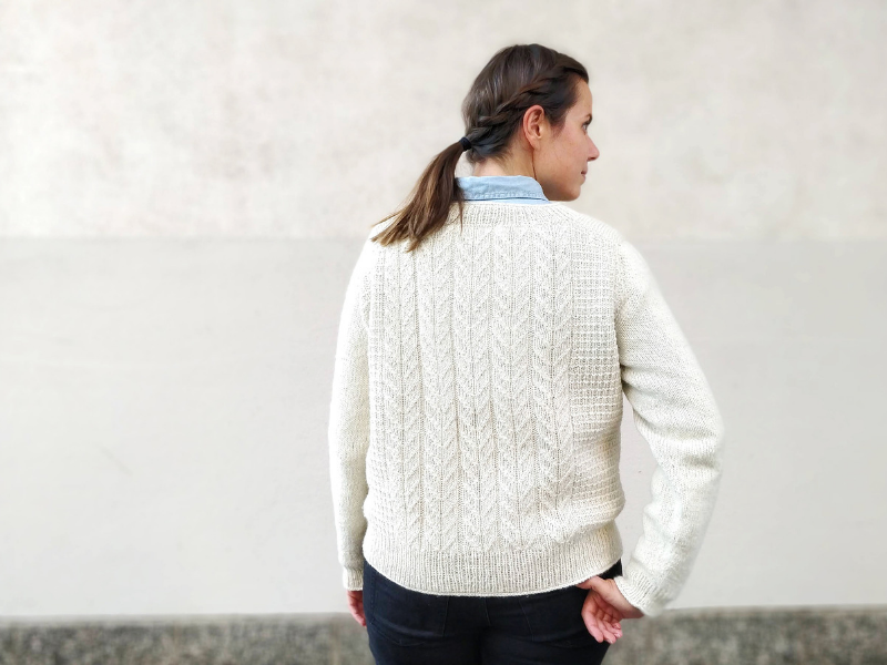 Sari Nordlund stood with her back to us wearing the Brandelhow sweater in Lore, Logical