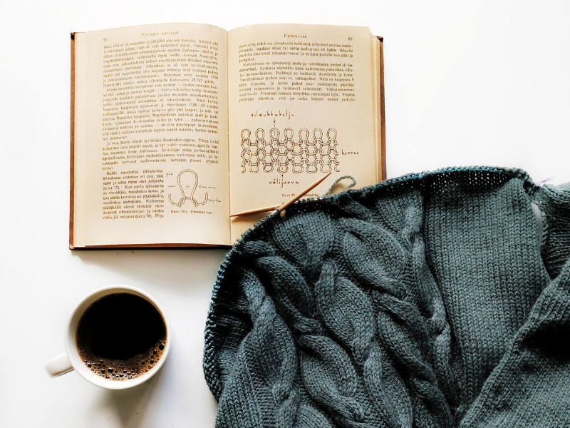 1940s knitting handbook with knitting project and coffee