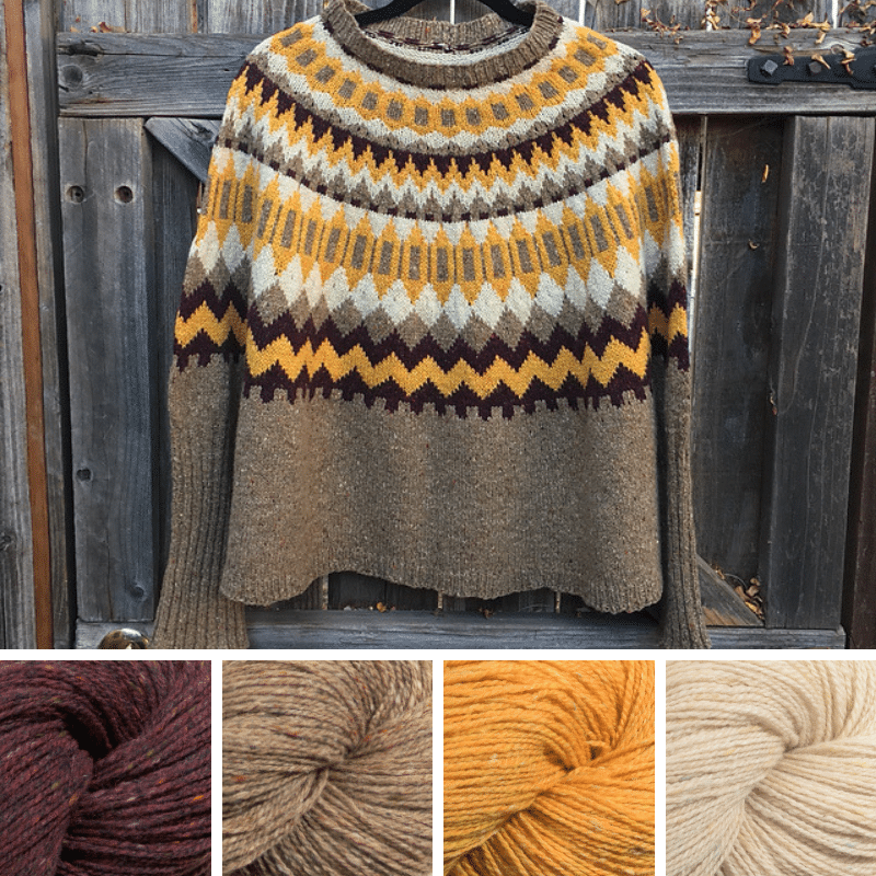 Colourwork sweater, on a hanger, in maroon, beige, yellow and cream