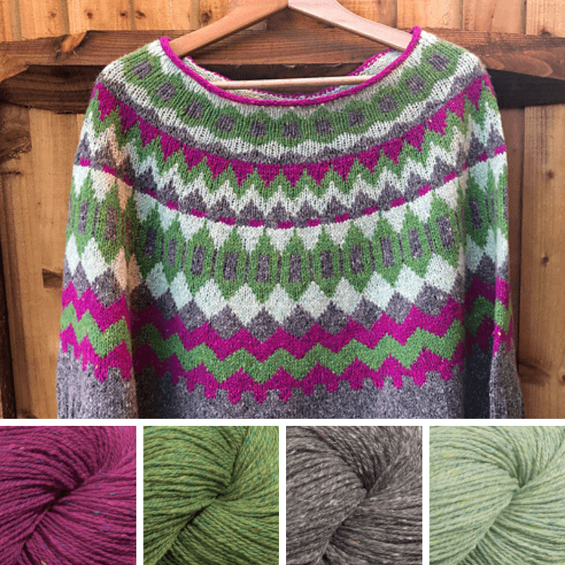 Colourwork sweater, on a hanger, in fuschia, green, mid-grey and pale green