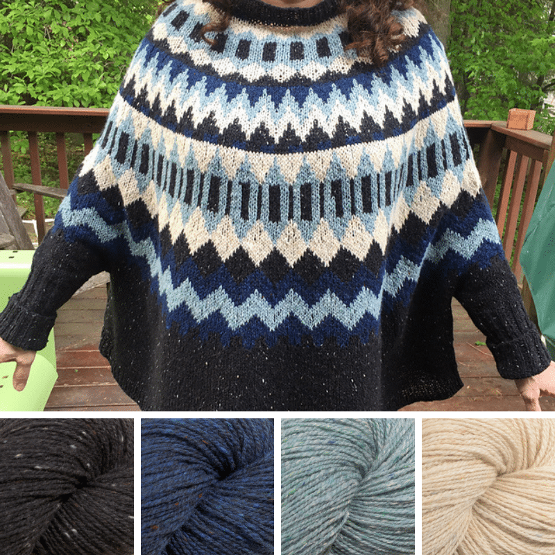 Woman wearing colourwork sweater in black, dark blue, pale blue and cream