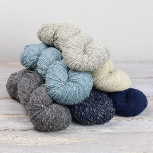 Selection of 6 different coloured skeins of yarn