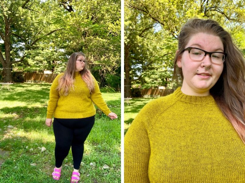 Courtney is wearing a vibrant yellow One Sweater with black trousers and pink sandals. She is standing on grass with lots of sunlight and trees behind her. In the second picture, she is showing off the lovely raglan shaping and neckband.   Introducing One Sweater: a Wardrobe Classic in Cumbria