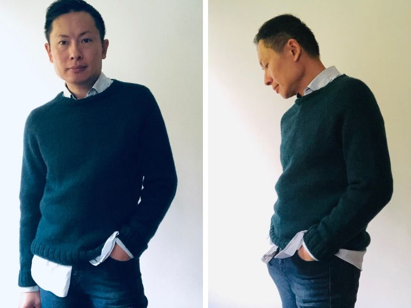 Jikon is wearing a navy One Sweater with jeans and a pale shirt. The sweater fits him immaculately! | Introducing One Sweater: a Wardrobe Classic in Cumbria