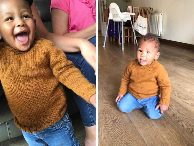 Kim's grandson is wearing a burnt orange One Sweater with jeans. He is only one year old and looks very happy and stylish is his jumper! | Introducing One Sweater: a Wardrobe Classic in Cumbria
