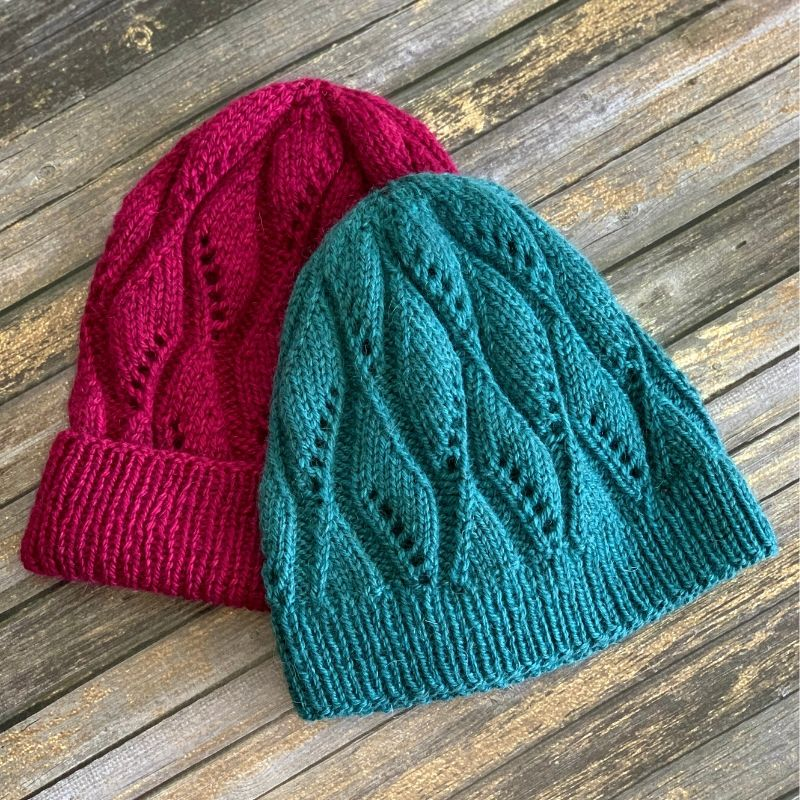 Lace beanie with two length and brim options in fuschia and turquoise.