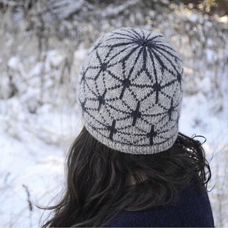 High-contrast stranded colourwork beanie in two shades of grey.