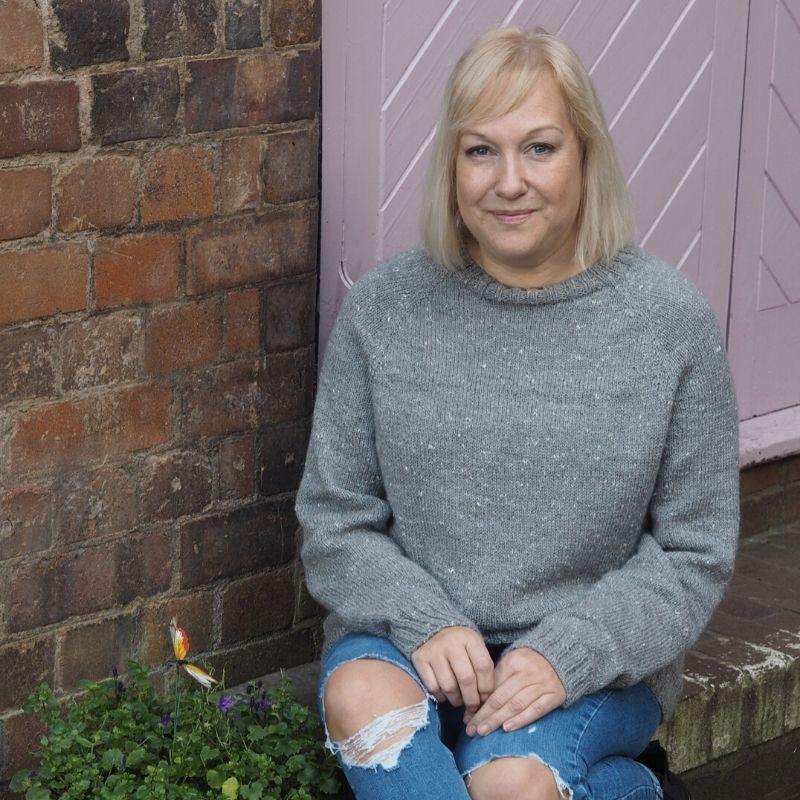 Deb wears a grey hand-dyed raglan sweater