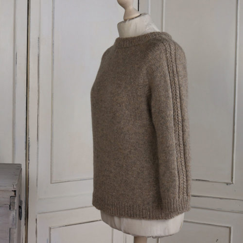 Rannerdale raglan pullover with pretty cables down the sleeves