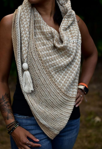 Woman wearing a two colour triangle shawl. Drift Blanket Shawl by Tif Neilan