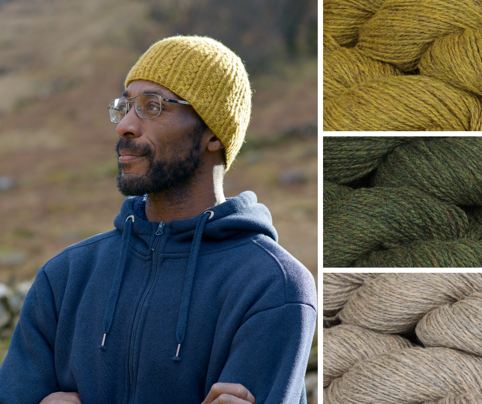 Hats are a great gift you can make. Nick wears Chapelfield in The Fibre Co. Lore. He is standing with arms crossed looking out across the fells in a navy hoody and yellow beanie hat pulled down over his ears.