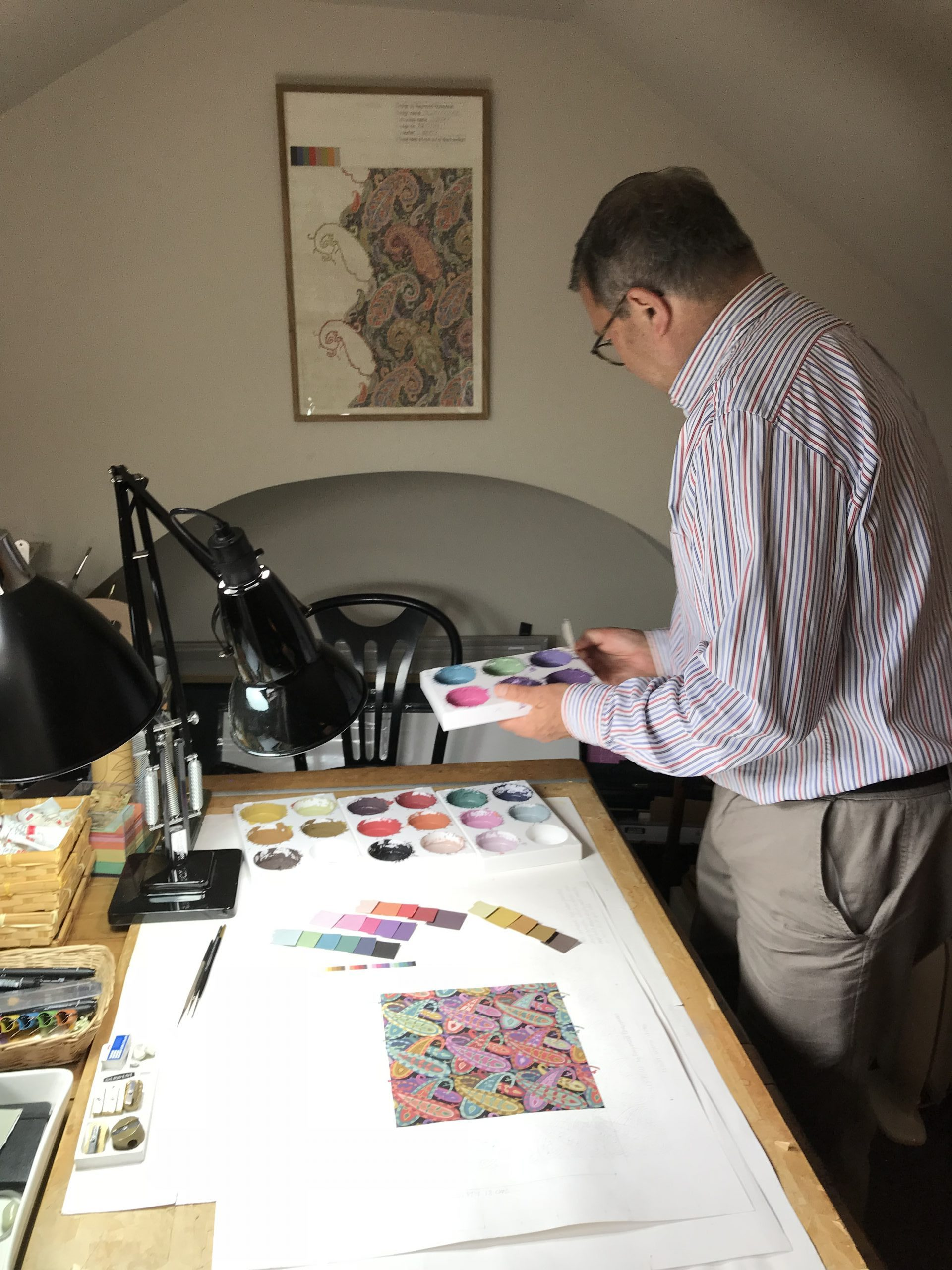 Textile designer, Raymond Honeyman working in his studio on a paisley pattern for The Fibre Co.
