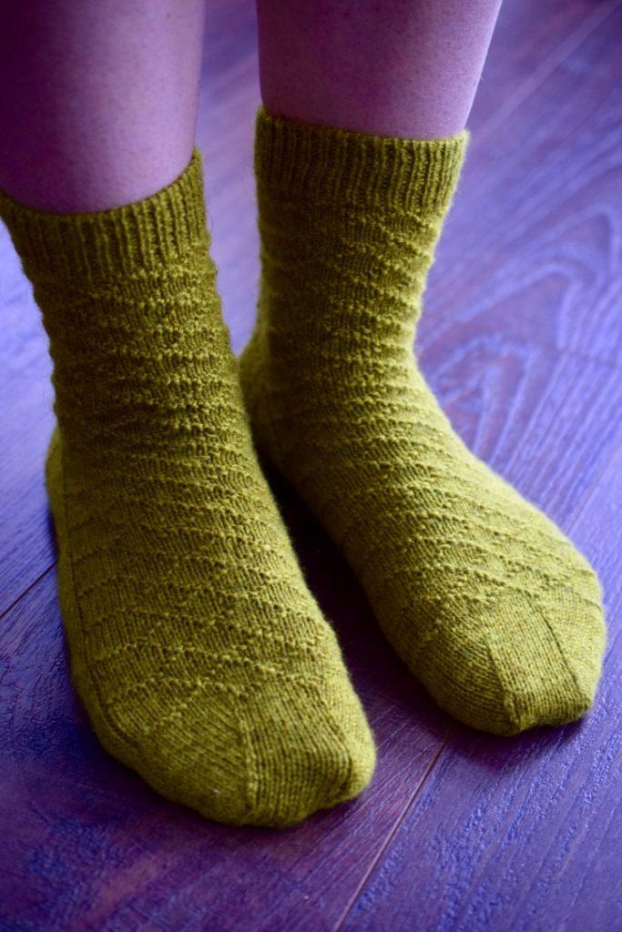 Mara Socks by Zsuzsanna Orthodoxou. Woman wearing pair of socks